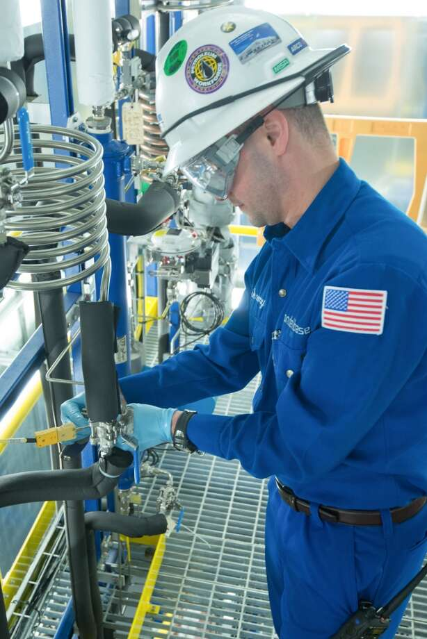 A pilot plant operator adjusts settings at the acetic acid pilot plant at LyondellBasell's new Houston Technology Center. Acetic acid is an important commodity chemical used to produce vinyl acetate, solvents and vinegar. Photo: Scott McCombs, LyondellBasell Industries