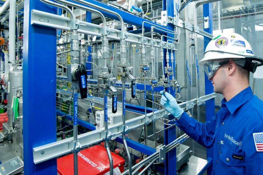 A pilot plant operator adjusts the liquid feed section of the acetic acid pilot plant. Photo: Scott McCombs, LyondellBasell Industries