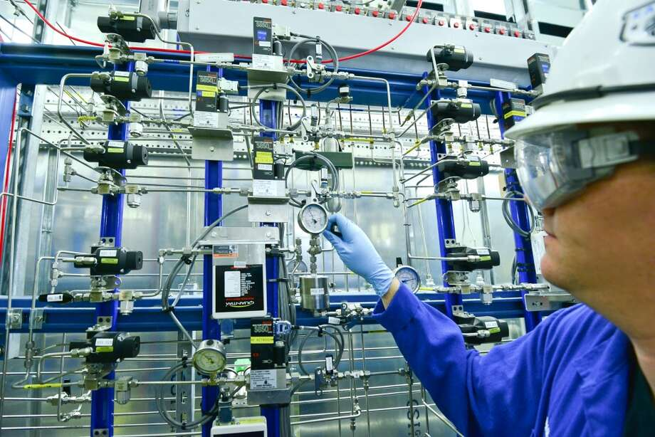 An employee works in the liquid feed section of the acetic acid pilot plant, which is a scale model of the acetic acid manufacturing unit in La Porte, Texas. Photo: Scott McCombs, LyondellBasell Industries