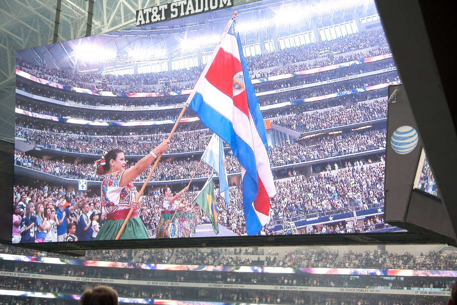Members of San Antonio's Ballet Folkórico Festival are seen on the AT&T Stadium's jumbotron as they perform on the field just before a Dallas Cowboys-St. Louis Rams game Sept. 22. The pre-game show was part of a Cowboys' celebration of Hispanic Heritage Month. Photo: Courtesy Photo