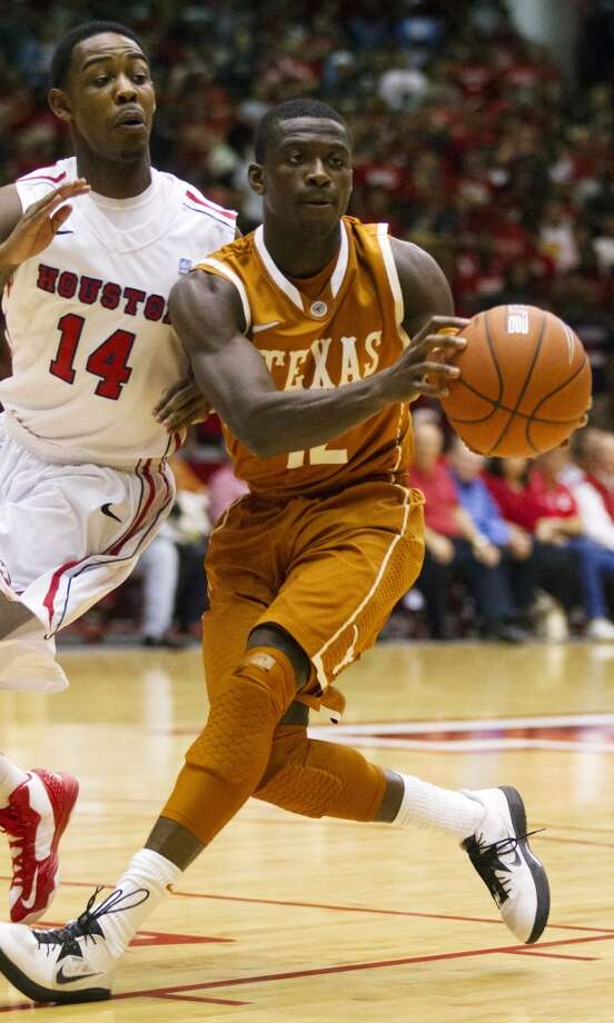 Myck Kabongo of Texas went undrafted after declaring for this year's draft. He has been invited to Spurs training camp. Photo: J. Patric Schneider, Associated Press