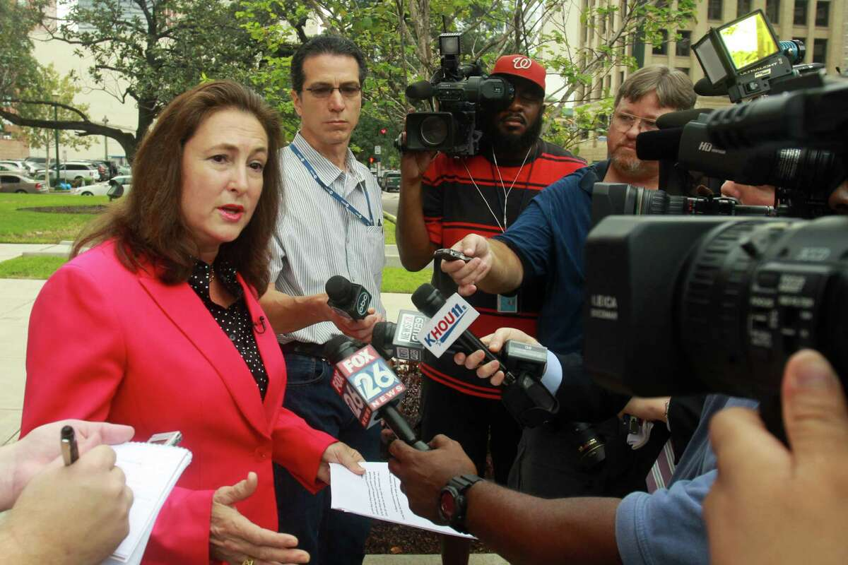 (For the Chronicle/Gary Fountain, September 30, 2013) Kim Ogg talks to media after announcing her candidacy for Harris County District Attorney.