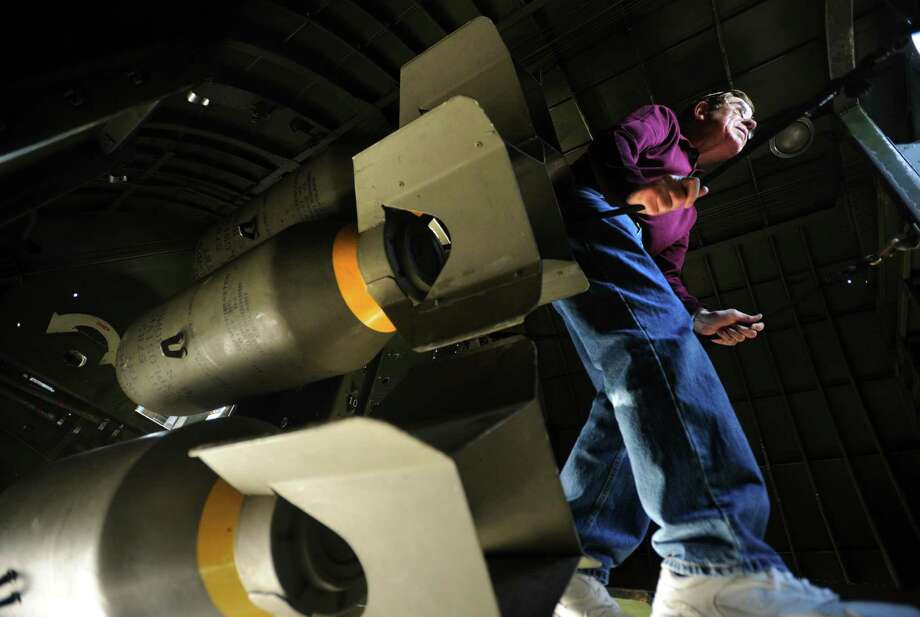 Tony Colasurdo of Stamford squeezes through the bomb bay of a World War II B-17 Flying Fortress bomber during a visit by the Wings of Freedom Tour to Sikorsky Airport in Stratford, Conn. on Monday, September 30, 2013. The B-17, along with a B-24 Liberator bomber and P-51 Mustang fighter are on display and available for tours and flights from 9 am- 5 pm on Tuesday and 9 am- noon on Wednesday. Photo: Brian A. Pounds / Connecticut Post