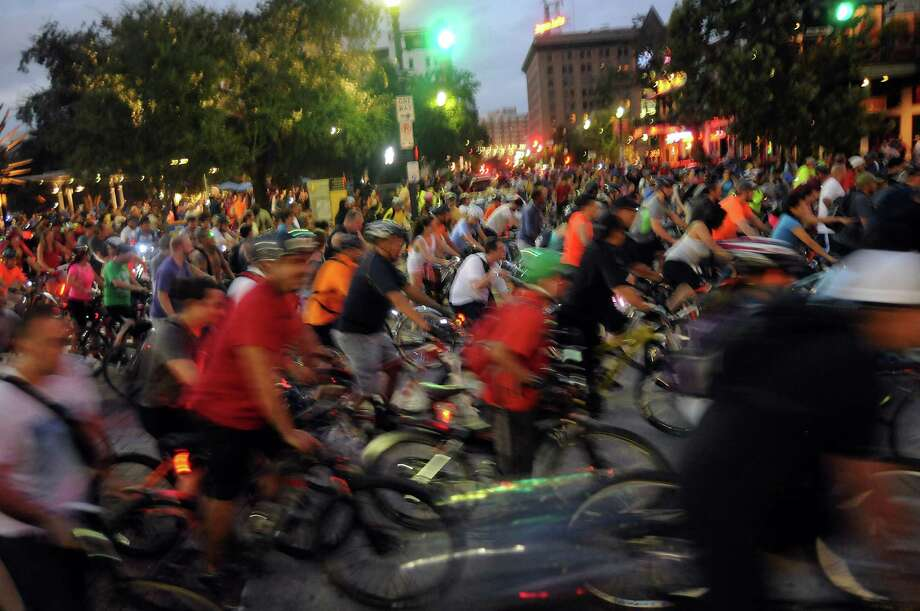 Bikers prepare to leave downtown during the Houston Critical Mass bike rideFriday Sept.27 2013.(Dave Rossman photo) Photo: Dave Rossman, Freelance / © 2013 Dave Rossman