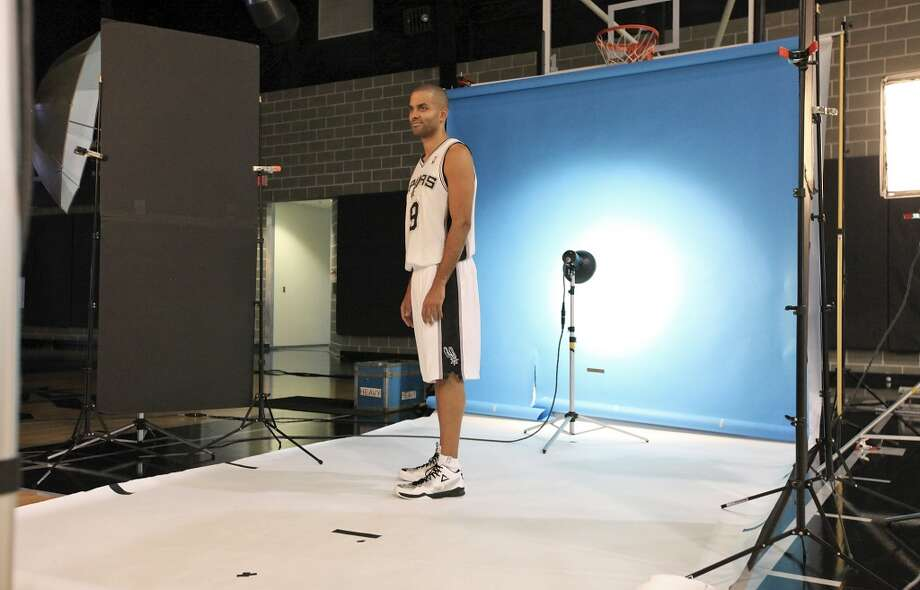 San Antonio Spurs' Tony Parker poses for a photo during media day Monday Sept. 30, 2013 at the team's practice facility. Photo: Edward A. Ornelas, San Antonio Express-News
