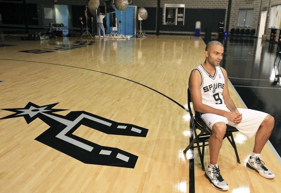 San Antonio Spurs' Tony Parker answers questions during media day Monday Sept. 30, 2013 at the team's practice facility. Photo: Edward A. Ornelas, San Antonio Express-News