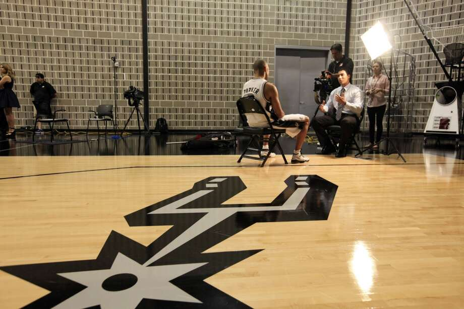 San Antonio Spurs' Tony Parker is interviewed during media day Monday Sept. 30, 2013 at the team's practice facility. Photo: Edward A. Ornelas, San Antonio Express-News