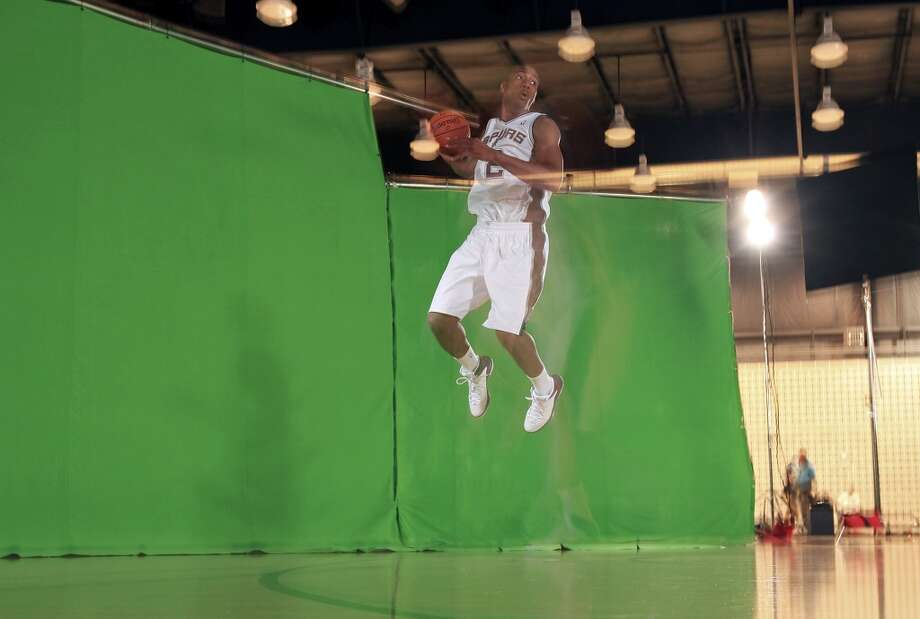 "San Antonio Spurs' Kawhi Leonard poses for a TimeSlice Films ""bullet-time"" effect photo during media day Monday Sept. 30, 2013 at the team's practice facility. Photo: Edward A. Ornelas, San Antonio Express-News"