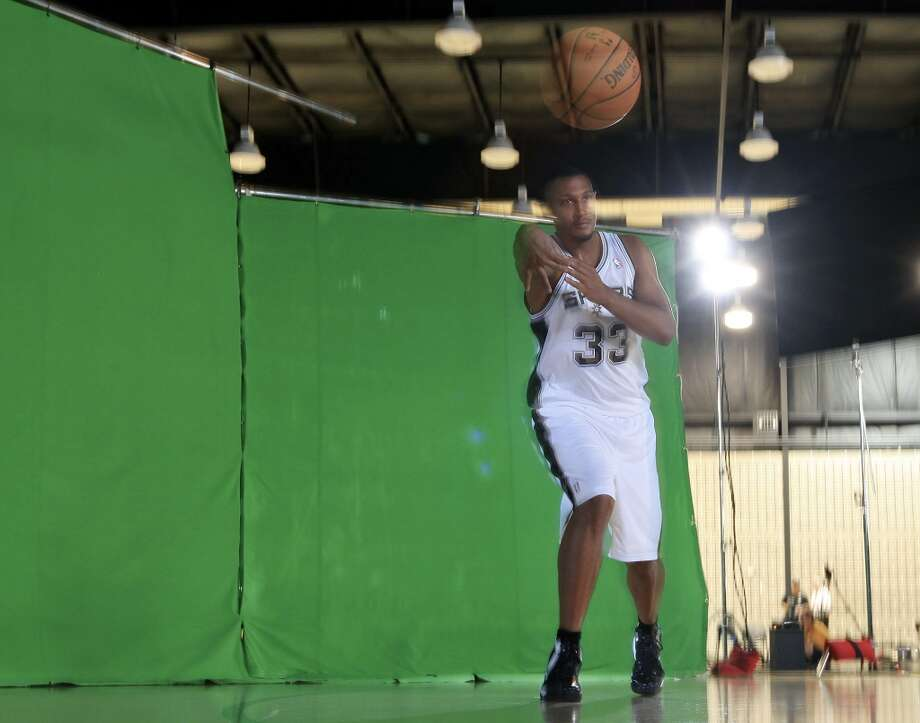 "San Antonio Spurs' Boris Diaw poses for a TimeSlice Films ""bullet-time"" effect photo during media day Monday Sept. 30, 2013 at the team's practice facility. Photo: Edward A. Ornelas, San Antonio Express-News"