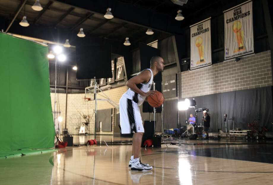 "San Antonio Spurs' Tony Parker poses for a TimeSlice Films ""bullet-time"" effect photo during media day Monday Sept. 30, 2013 at the team's practice facility. Photo: Edward A. Ornelas, San Antonio Express-News"