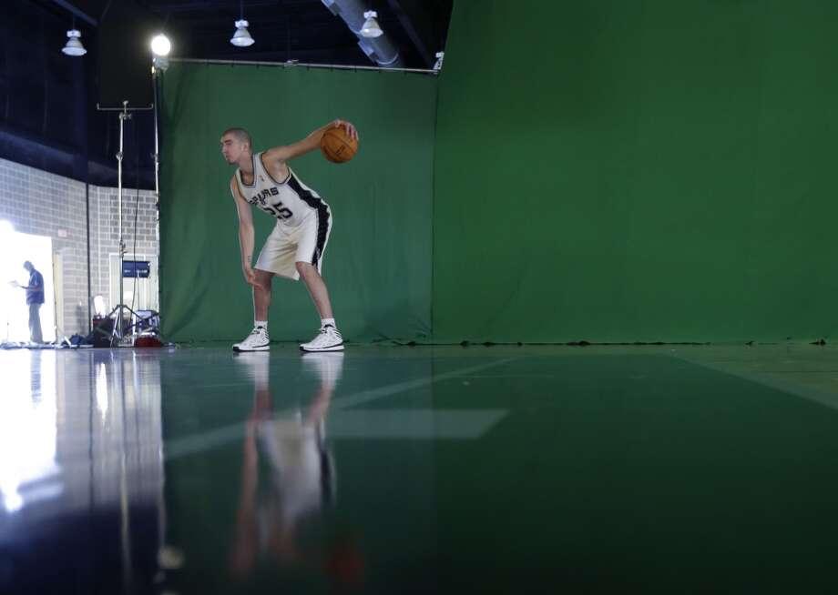 San Antonio Spurs' Nando De Colo, of France, poses for a photo during their NBA basketball media day, Monday, Sept. 30, 2013, in San Antonio. Photo: Eric Gay, Associated Press