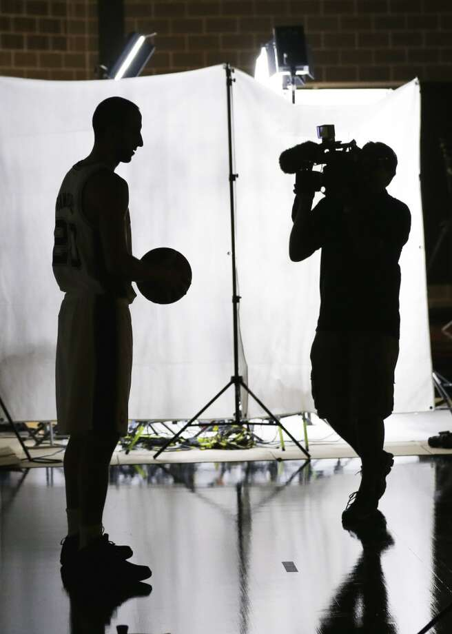 San Antonio Spurs' Manu Ginobili, left, of Argentina, poses for a photos during the team's NBA basketball media day, Monday, Sept. 30, 2013, in San Antonio. Photo: Eric Gay, Associated Press