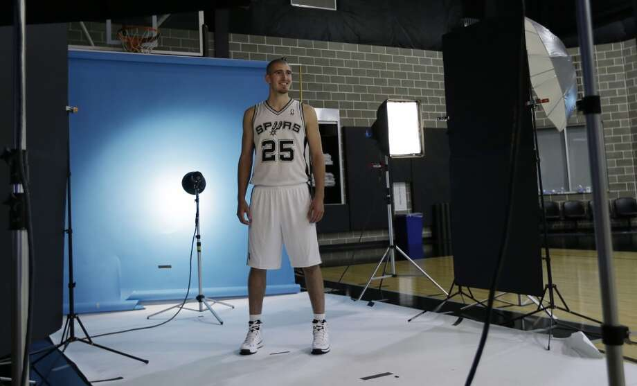 San Antonio Spurs' Nando De Colo, of France, poses for a photo during their NBA basketball media day, Monday, Sept. 30, 2013, in San Antonio. Photo: Eric Gay, Associated Press