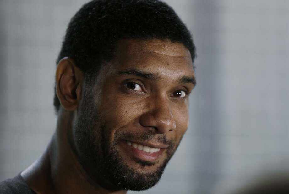 San Antonio Spurs' Tim Duncan, center, talks to reporters at the team's workout facility during their NBA basketball media day, Monday, Sept. 30, 2013, in San Antonio. Photo: Eric Gay, Associated Press