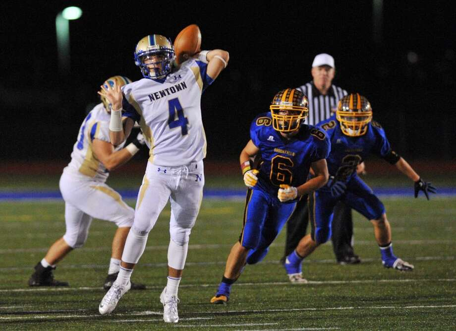 Newtown quarterback Andrew Tarantino (4) throws in the SWC high school football game between Brookfield and Newtown at Brookfield High School in Brookfield, Conn. on Friday, Sept. 27, 2013. Photo: Tyler Sizemore