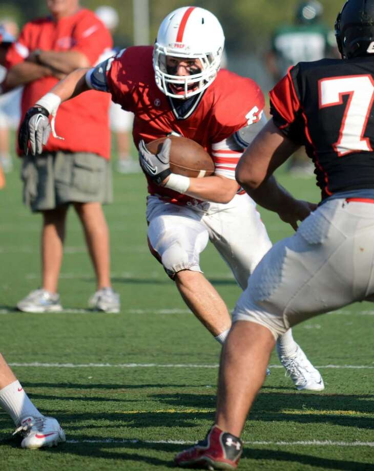Fairfield Prep's Joe Ganim carries the ball Tuesday, Aug. 27, 2013 during their scrimmage with Fairfield Warde at Fairfield Warde High School in Fairfield, Conn. Photo: Autumn Driscoll