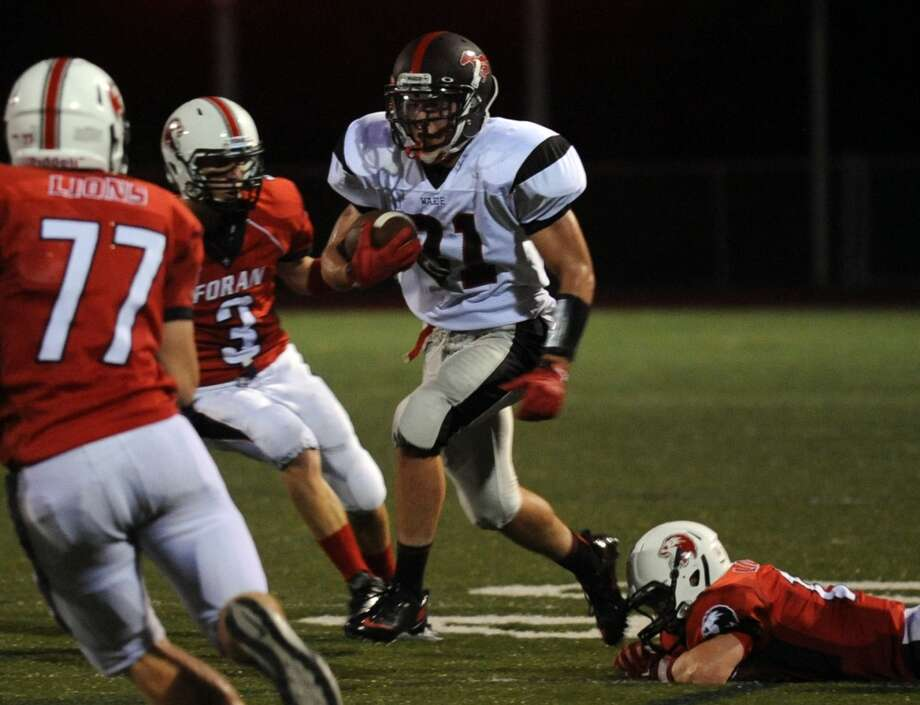 Fairfield Warde's T.J. Gallagher carries the ball, during the opening night of high school football action against Foran in Milford, Conn. on Wednesday September 11, 2013. Photo: Christian Abraham