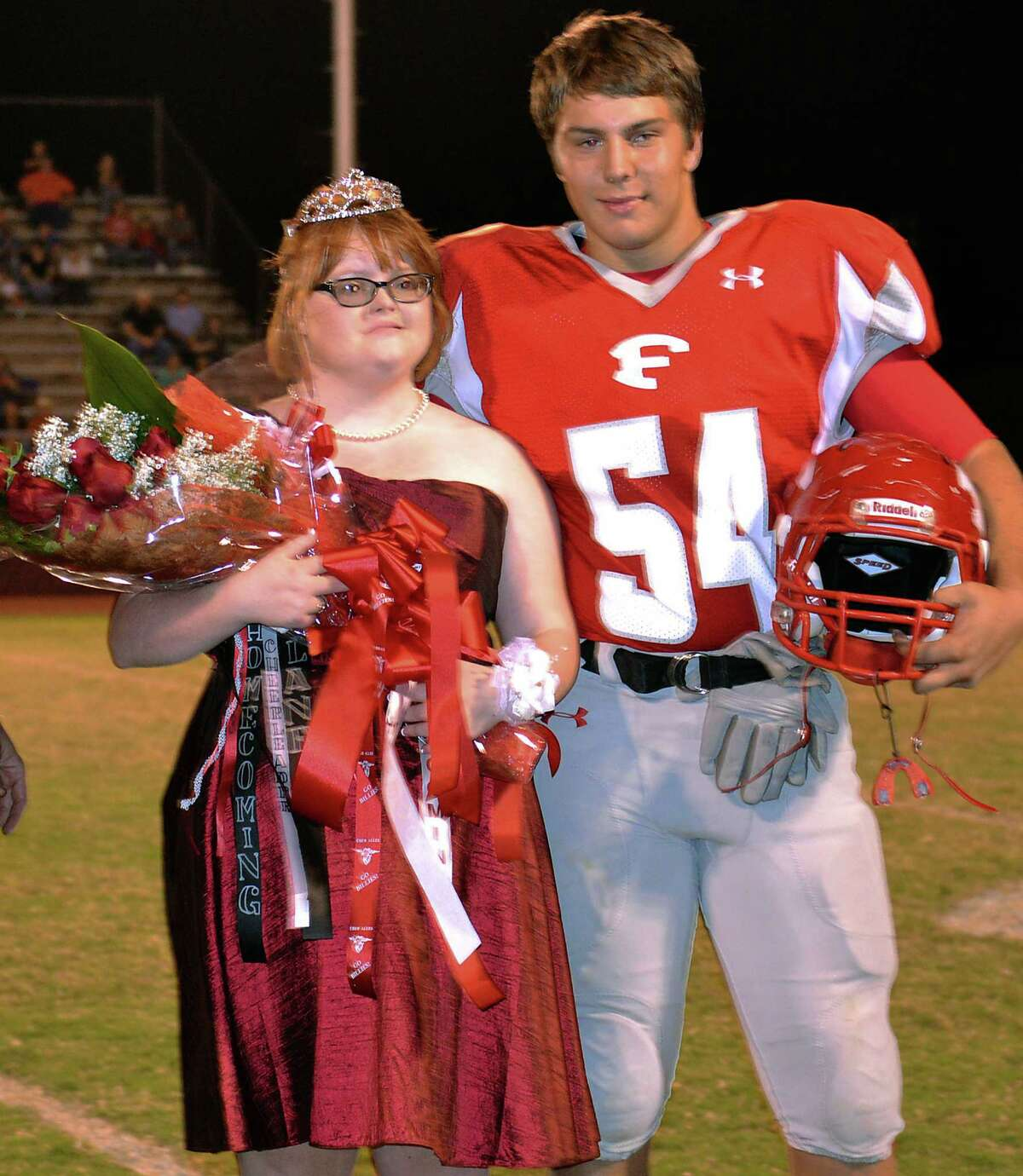 Libby Klein, left, stands with her escort Lane Williams after being crowned Homecoming Queen of Fredericksburg High School Saturday night.