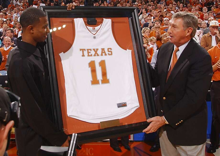 Former Texas guard T.J. Ford, left, accepts his framed No. 11 jersey from University of Texas athletic director Deloss Dodds during halftime of the Longhorns' 66-37 win over Oklahoma on Sunday, Feb. 8, 2004, in Austin.  (AP Photo/University of Texas, Steve Moakley). Photo: STEVE MOAKLEY, AP