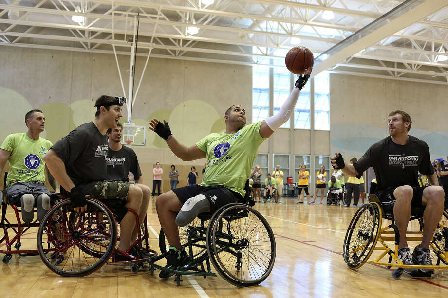 Spurs players Aron Baynes, from left, Tiago Spitter and Matt Bonner go up against the winning 3-vs-3 wheelchair basketball competition team including Matt Spang, far left, and Edwin Gonzalez, center, Sept. 24 during an exhibition at the Valor Games Southwest. Photo: Lisa Krantz / San Antonio Express-News