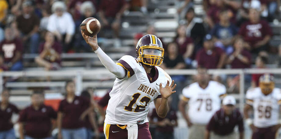 Harlandale quarterback Brandon Ramon (12) fires a pass to an awaiting receiver against Medina Valley during their game at Panther Stadium in Castroville. Photo: Photos By Kin Man Hui / San Antonio Express-News
