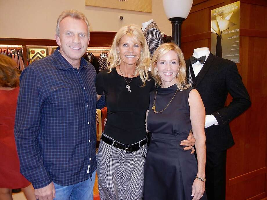 Joe and Jennifer Montana (left) with Brooks Brothers CEO Vivien Kronengold. Photo: Catherine Bigelow, Special To The Chronicle