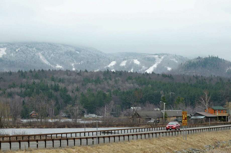 A view looking across Route 30 with the Big Tupper ski hill seen in the background in 2012 in Tupper Lake, NY. ( Times Union archive) Photo: Paul Buckowski / 00017012A
