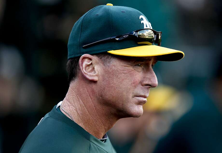 A's manager Bob Melvin watches things from the dugout as the Oakland Athletics went on to beat the Minnesota Twins 9-1 on Saturday Sept. 21, 2013, in Oakland, Calif. Photo: Michael Macor, The Chronicle