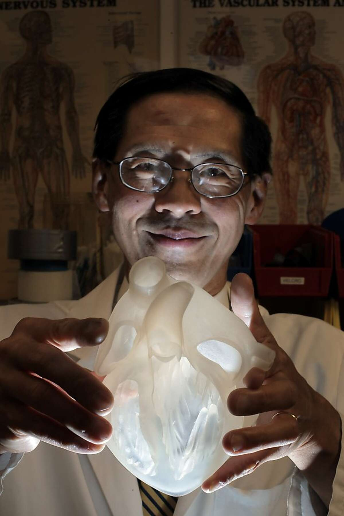 Dr. Paul Wang is creating 3D models of the human heart at Stanford University using 3D printers to assist in the fabrication of instruments for cardiac patients. He is seen here on Thursday, September 12, 2013, in the Collab at the Clark Center where the items are printed.
