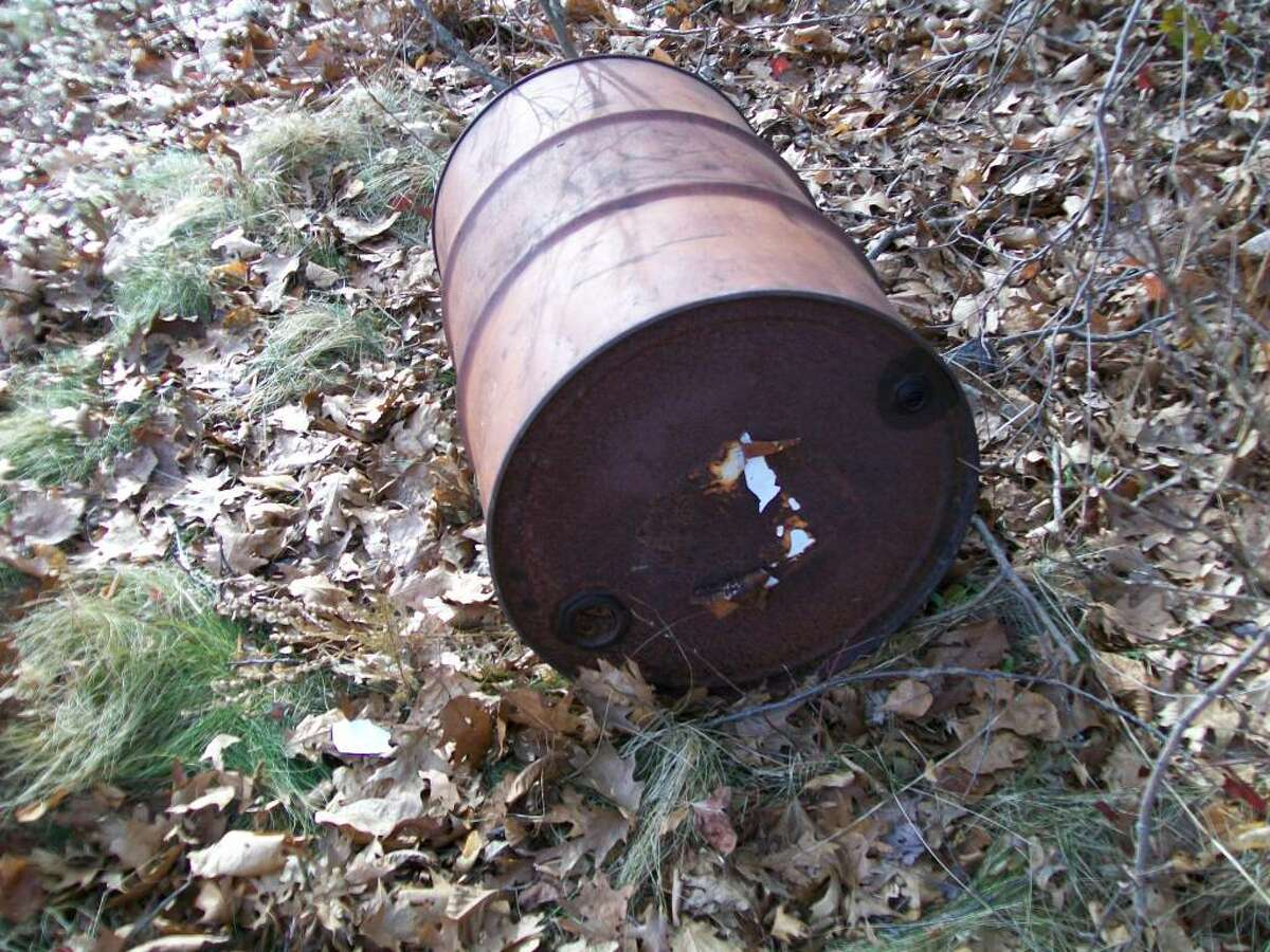 A barrel potentially containing hazardous materials discovered on Scofield Magnet Middle School property on Saturday.