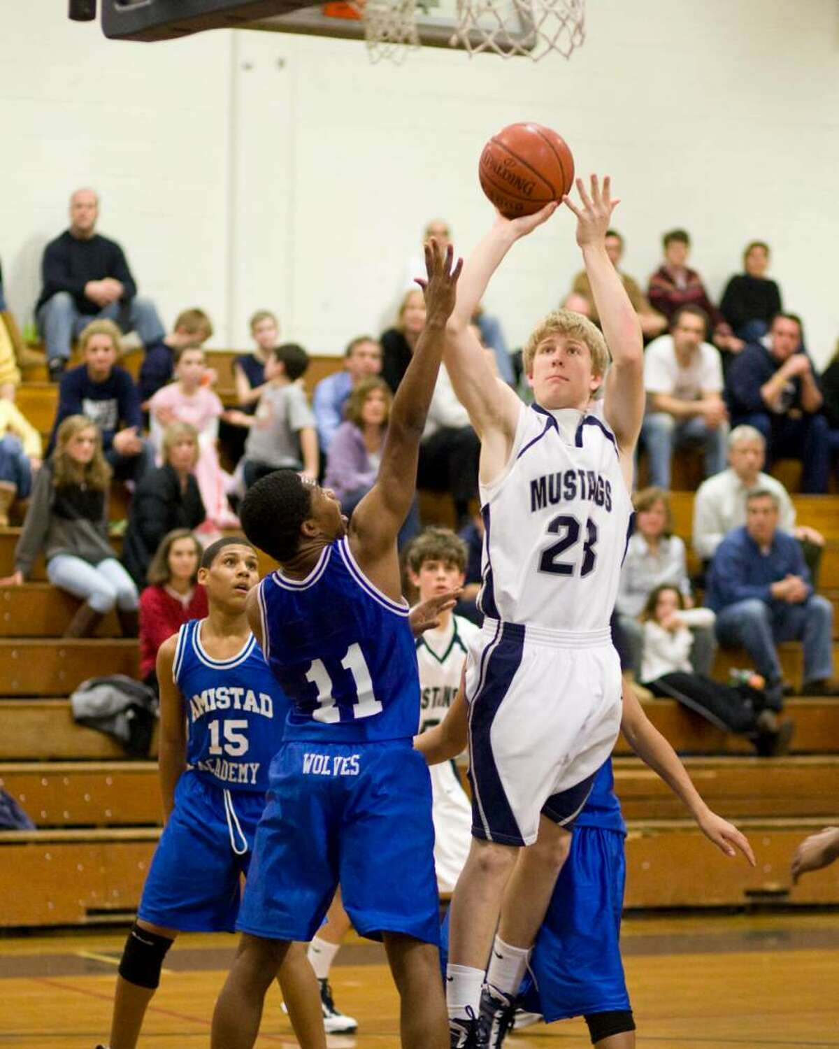 Immaculate's Grant Braun puts up a shot over Shama Talton (11) of Amistad Academy Monday night at Immaculate High.