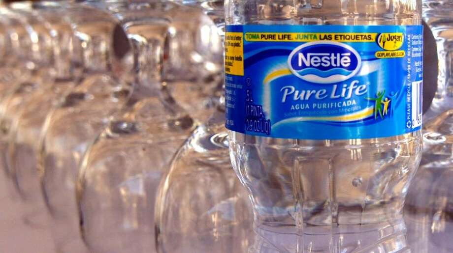 "A look at the New Pure Life water as Nestle Waters opens its second plant in Upper Macungie Township. It is a certifed ""green"" building and uses bottles for its water that contain less plastic than any of its competitors. The plant will receive up to .75 million through PennDOT's Transportation Program to improve the I-78/PA 100 interchange in the township. The Nestle plant has hired 115 workers. Photo taken Monday, October 22, 2007. (Kathleen X. Cook/TMC) \with story by Mr. Spencer Soper Photo: Contributed Photo / Stamford Advocate Contributed"