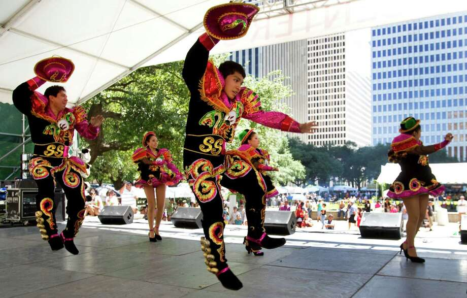 Caporales San Simon perform a Bolivian dance during the Houston International Festival Sunday, April 22, 2012. Photo: Brett Coomer, Houston Chronicle / 2012 Houston Chronicle
