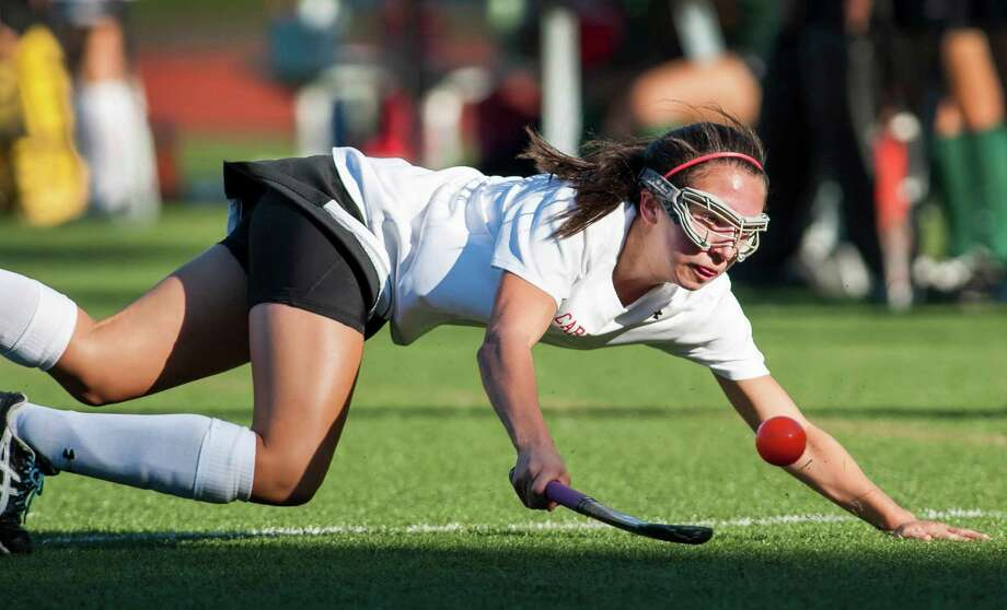 Greenwich high school's Paige Mautner tries to keep the ball inbounds during a girls field hockey game against Norwalk high school played at Greenwich high school, Greenwich, CT on Monday September, 30th, 2013. Photo: Mark Conrad / Stamford Advocate Freelance