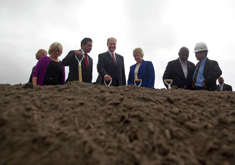 Gary Kelly, CEO, Southwest Airlines, center, and Houston Mayor Annise Parker along with representatives from the city and the Houston Airport System prepare to break ground on what will be the new international terminal at William P. Hobby Airport Monday, Sept. 30, 2013, in Houston. 