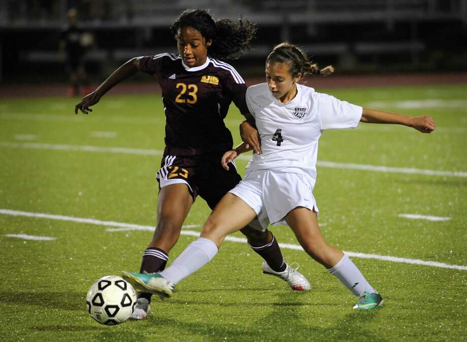 St. Joseph's Leah Lewis, left, competes for the ball with Trumbull's Francesca Esposito during the first half of their FCIAC girls soccer matchup at Trumbull High School in Trumbull, Conn. on Monday, September 30, 2013. Photo: Brian A. Pounds / Connecticut Post