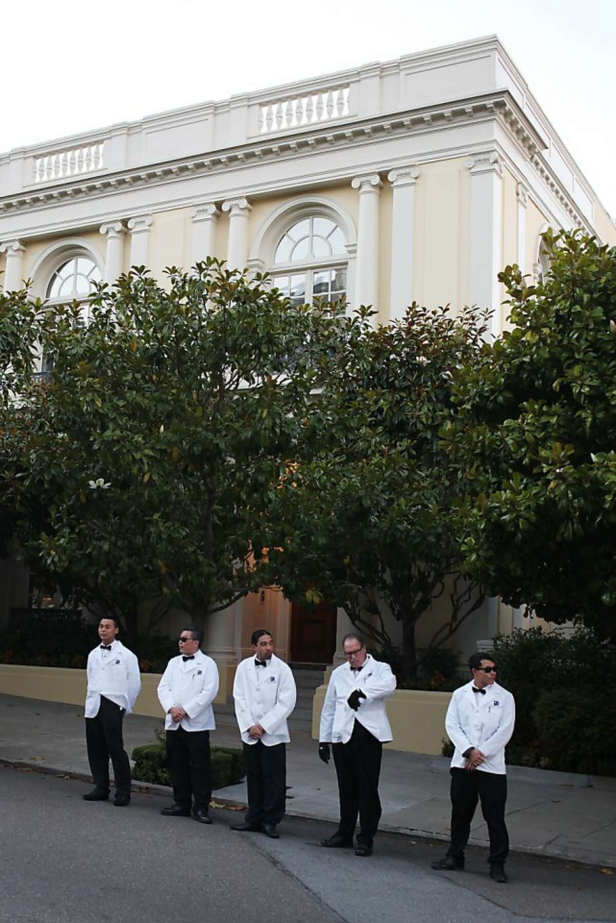 Valets wait to park cars for a private event on Broadway Street on September 25, 2013 in the Pacific Heights area of San Francisco, Calif.