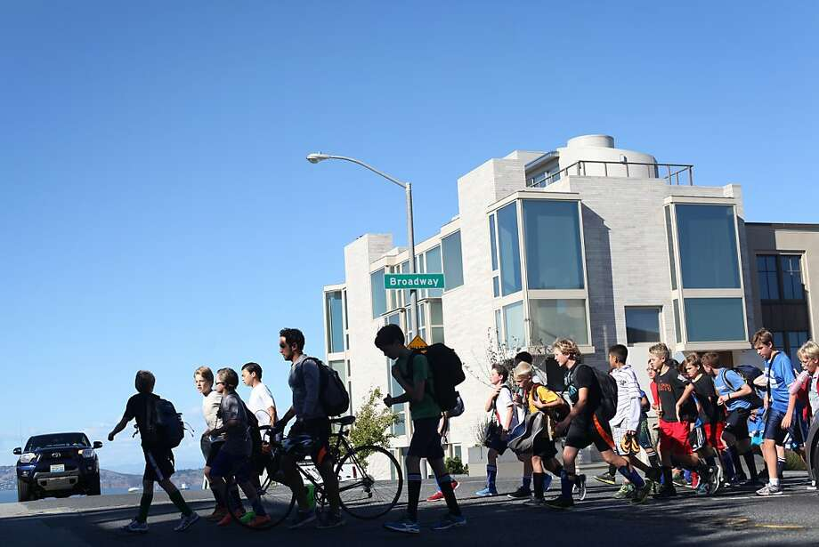 Students from Town School for Boys crest the hill of Broadway in Pacific Heights on their way to soccer. Photo: Pete Kiehart, The Chronicle