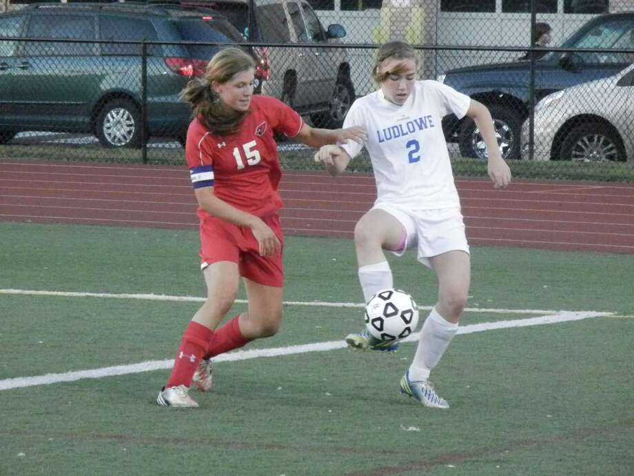 Greenwich's Liz Warner (15) challenges Fairfield Ludlowe's Regan Steed (2) in first-half action on Monday, Sept. 30 in an FCIAC girls soccer match at Taft Field in Fairfield. The Falcons won 2-0. Photo: Reid L. Walmark / Fairfield Citizen