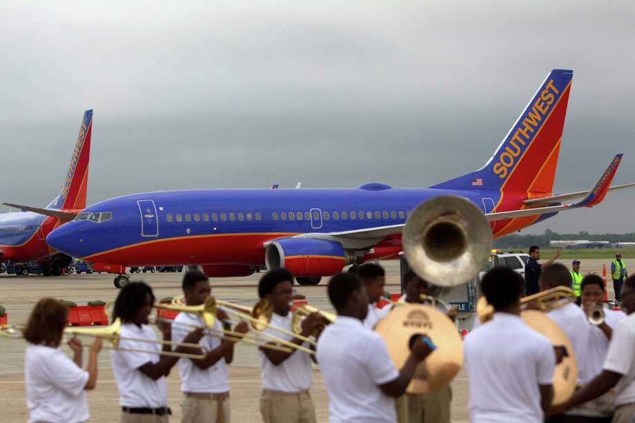 Members of the Sterling Aviation Magnet High School band practice before Gary Kelly, CEO, Southwest Airlines, Houston Mayor Annise Parker and city officials broke ground on what will be the new international terminal at William P. Hobby Airport Monday, Sept. 30, 2013, in Houston.  The estimated completion date is late 2015. Southwest Airline is fully funding the new, five-gate international terminal at an estimated cost of $156 million. ( Johnny Hanson / Houston Chronicle ) Photo: Johnny Hanson, Staff / Houston Chronicle