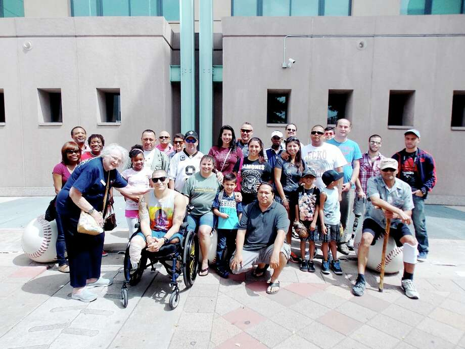 Dottie Wainwright of the Heritage Trails chapter of the Daughters of the American Revolution greets soldiers and families arriving for a Houston Astros game Sept. 15. Photo: Provided By The National Society Of The Daughters Of The American Revolution