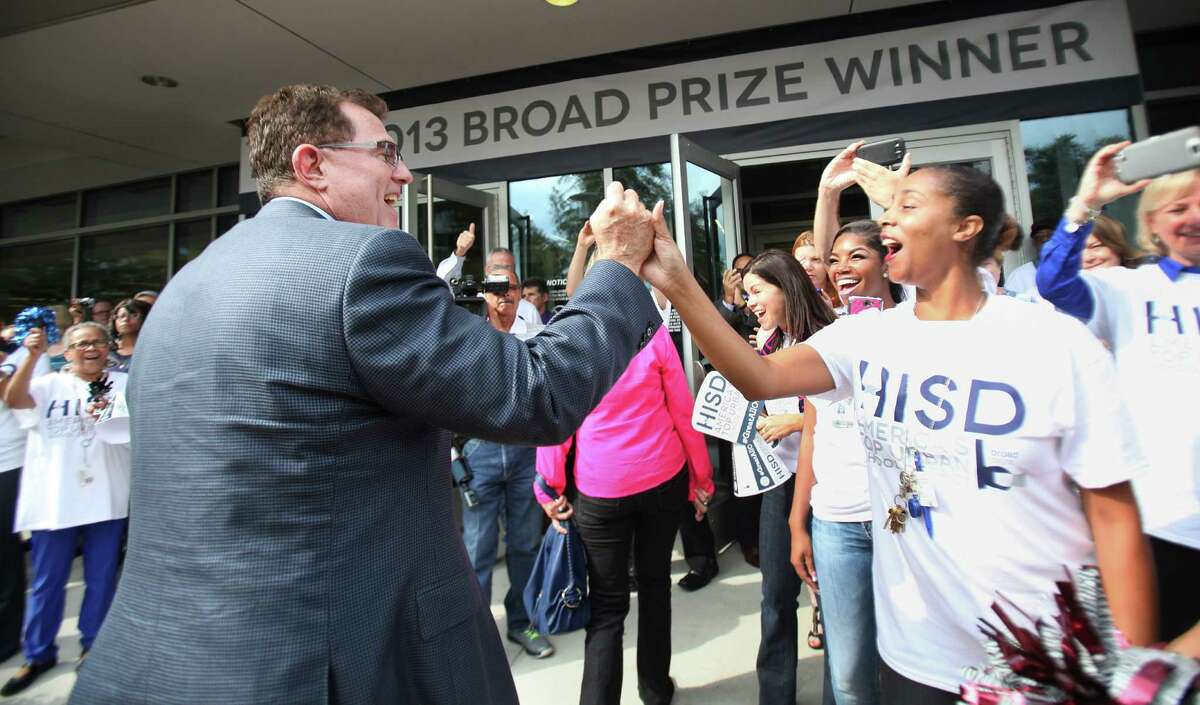 HISD Superintendent Terry Grier greeted Alicia McAfee as students, teachers and administrators gathered to celebrate after the district won the 2013 Broad Prize for Top Urban Education.