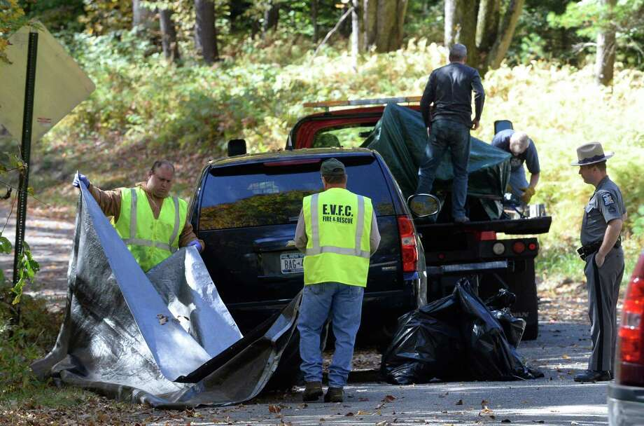 State Police investigators and Edinburg fire personnel package up the remains of a wrecked aircraft Monday afternoon, Sept. 30, 2013, in Edinburg, N.Y. The aircraft went down Sunday evening killing its pilot. (Skip Dickstein / Times Union) Photo: Skip Dickstein