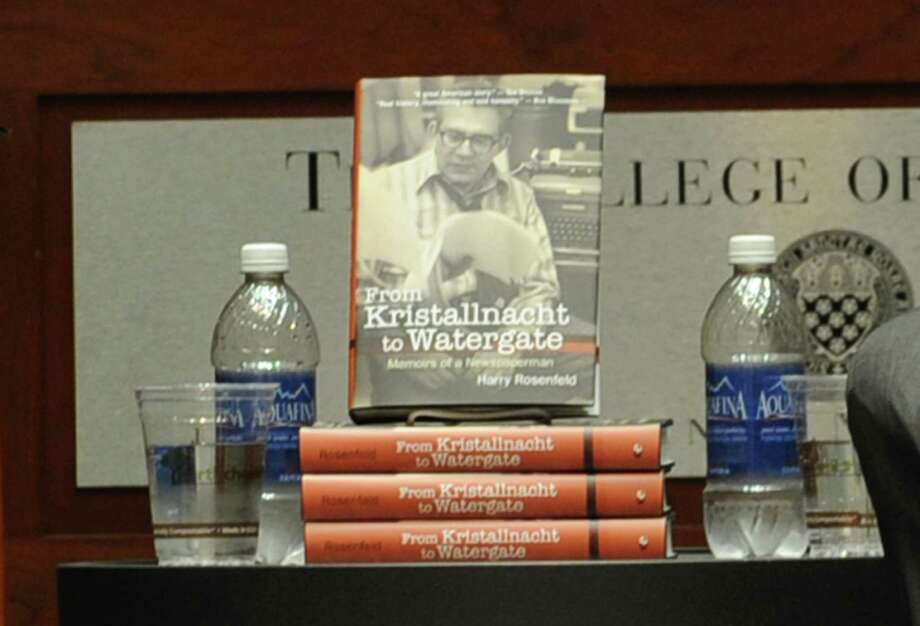 "Newspaper editor Harry Rosenfeld's new book, ""From Kristallnacht to Watergate: Memoirs of a Newspaperman"" is displayed next to him as he speaks about the book at The College of Saint Rose on Monday Sept. 30, 2013 in Albany, N.Y.  (Lori Van Buren / Times Union) Photo: Lori Van Buren / 00024053A"