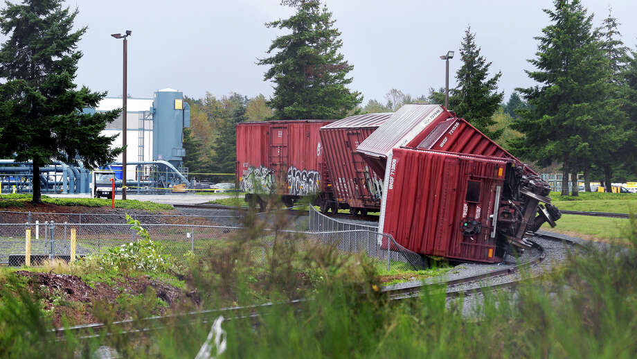 Rail cars are overturned near Boeing's Frederickson facility in Puyallup, Wash., Monday, Sept. 30, 2013 after a tornado came through the area earlier in the morning.  Photo: Ted S. Warren, Associated Press / Associated Press