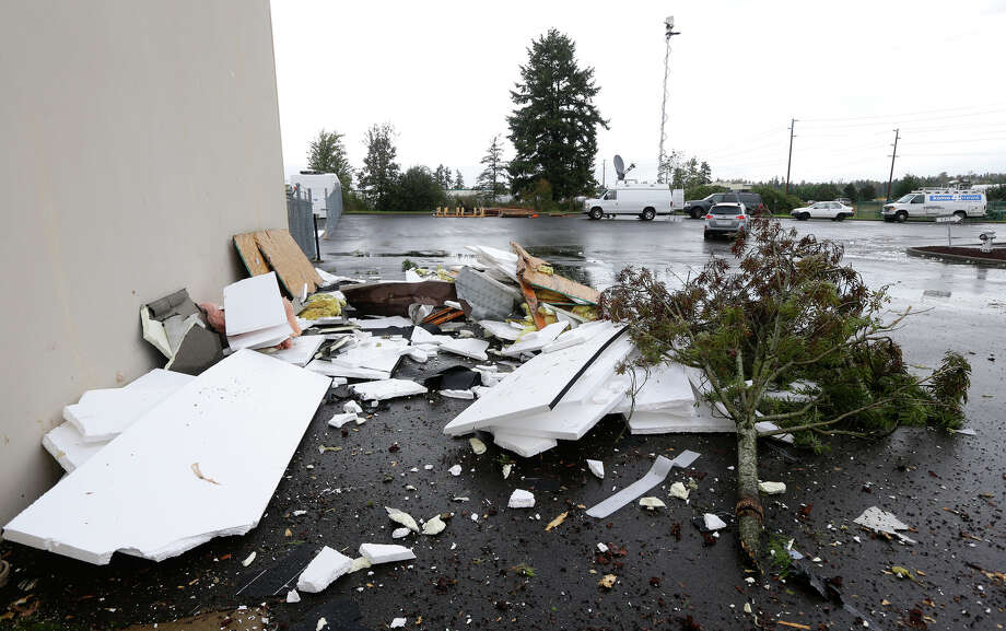 A pile of debris is shown at Northwest Door in Puyallup, Wash., Monday, Sept. 30, 2013. The building was damaged when a tornado moved through the area earlier in the day. Photo: Ted S. Warren, Associated Press / Associated Press