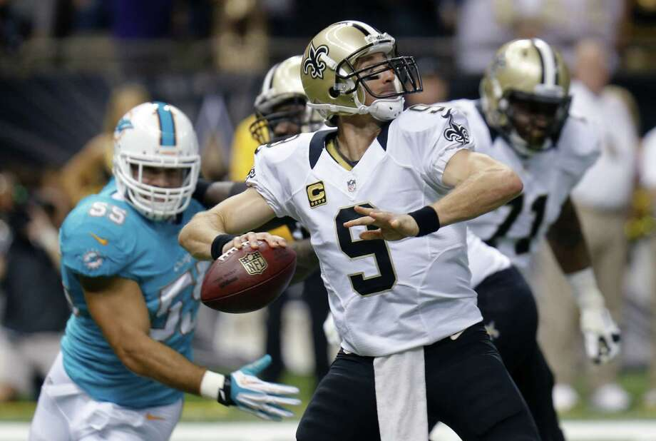 New Orleans Saints quarterback Drew Brees (9) passes as Miami Dolphins outside linebacker Koa Misi (55) rushes in the first half of an NFL football game in New Orleans, Monday, Sept. 30, 2013. (AP Photo/Bill Haber) ORG XMIT: NUA104 Photo: Bill Haber / FR170136 AP