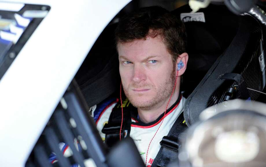 Dale Earnhardt Jr. looks on before practice for Sunday's NASCAR Sprint Cup series auto race, Saturday, Sept. 28, 2013, at Dover International Speedway in Dover, Del. (AP Photo/Nick Wass) ORG XMIT: DOV102 Photo: Nick Wass / FR67404 AP