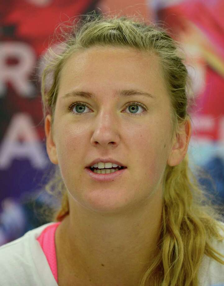 Belarus's tennis player Victoria Azarenka answers questions during the round table interview in the Pan Pacific Open tennis tournament in Tokyo on September 22, 2013.     AFP PHOTO/Toru YAMANAKATORU YAMANAKA/AFP/Getty Images Photo: TORU YAMANAKA, Staff / AFP