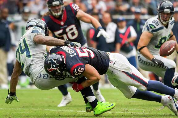 Texans inside linebacker Brian Cushing had six tackles, including this hit on Seahawks running back Marshawn Lynch, in the first half before missing the fourth quarter of Sunday's game because of a concussion.